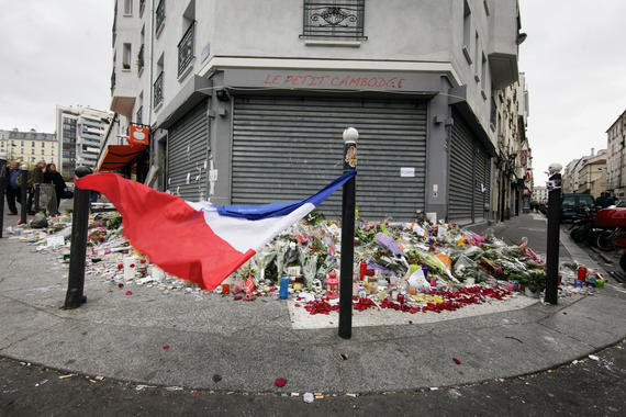 16 Nov 2015, Paris, France --- 16 November 2015 – Paris, France Mourners lay flowers and light candles in front of Le Petit Cambodge restaurant in central Paris where people were gunned down. In a series of acts of violence, some 129 people were killing in shootings and suicide bombing. ISIL or islamic state claimed the responsibility. --- Image by © Leo Novel/Corbis