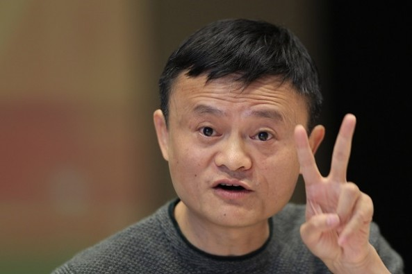 Jack Ma, executive chairman of the Alibaba Group, gestures during a press conference with the Pac-12 in Hangzhou in eastern China's Zhejiang province Tuesday, Nov. 10, 2015. On Saturday, two men's basketball teams from the University of Washington and the University of Texas will contest the first-ever regular season college basketball game in China, the first of perhaps many for U.S. university teams as they try to tap into a new market for their sports - and their schools - in the world's second-biggest economy. (AP Photo)